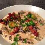 Viltgryte med bacon, champignon, amandinepotet og tyttebær
